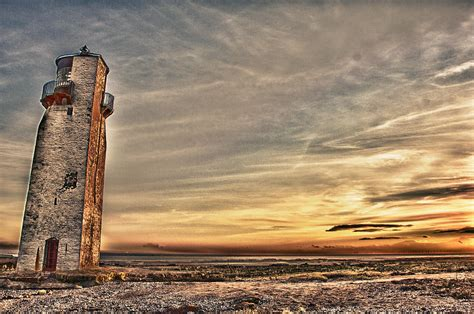 light house at lighthouse at southerness photograph by derek beattie