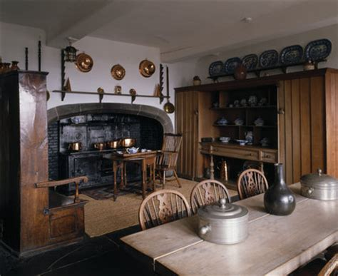the kitchen, showing the coal fired range, with copper and