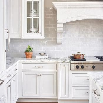 mini subway tile kitchen backsplash white and gray kitchen with red accents transitional