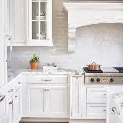 white kitchen with gray brick tiles