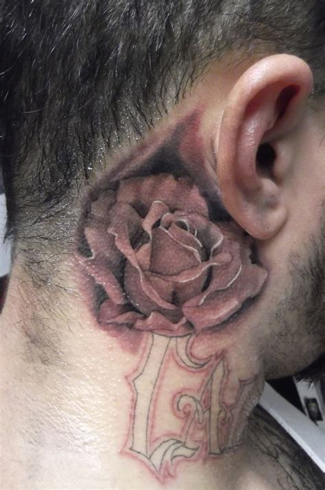 behind the ear rose tattoo black and grey on the ear