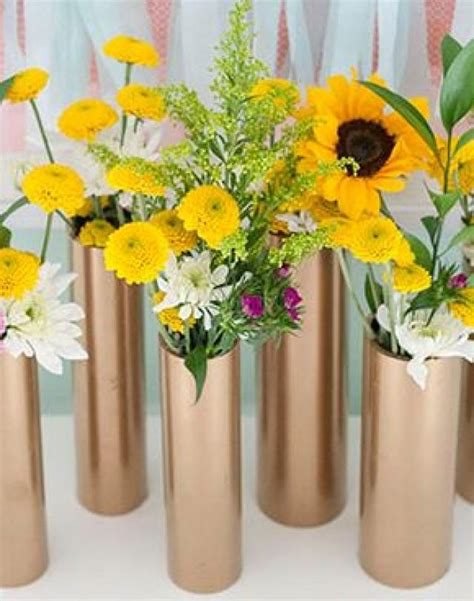 how to make cheap centerpieces make a modern centerpiece using just gold spray paint and pvc pipe 2323015 weddbook