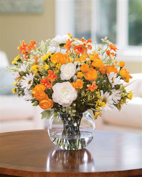 happy daisy ranunculus silk flower centerpiece at petals