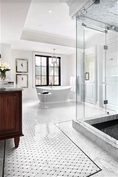 traditional master bathroom  carrara white