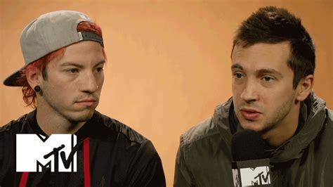 21 pilots tattoo neck and hands twenty one pilots explain why their album is called