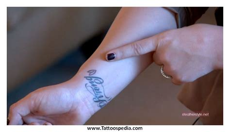 cross tattoo on finger meaning tony baxter