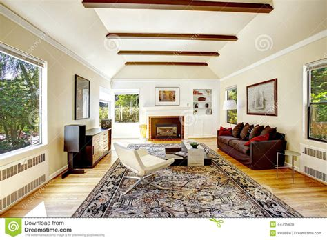 Free Log Cabin Floor Plans vaulted ceiling with brown beams in living room stock