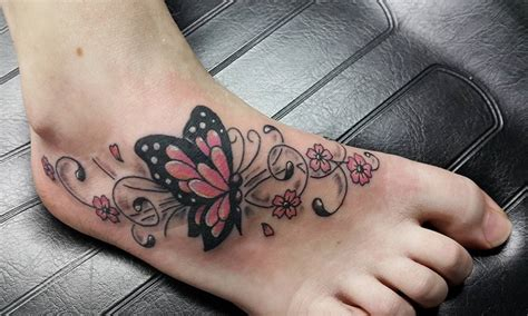 vlinder tattoo op voet tattooshop ink heaven