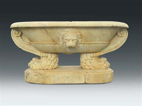 vasca in marmo vasca ovale in marmo bianco scolpita con decori ferini
