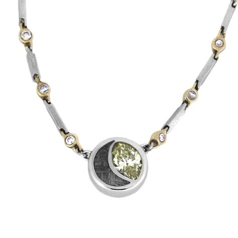 meteorite and peridot pendant necklace in platinum with