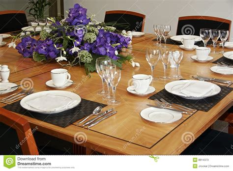 table setup restaurant table setup with cut flowers stock image
