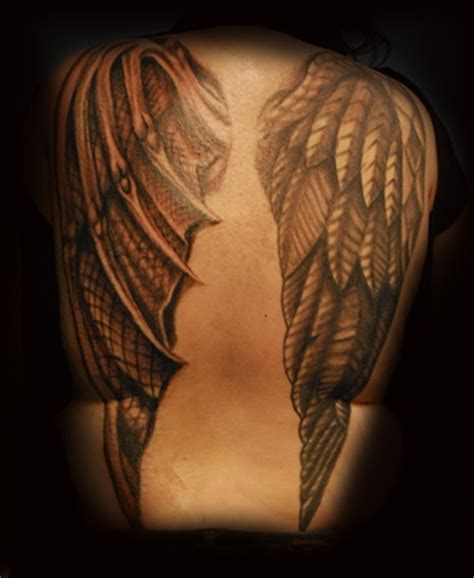 david zobel tattoo artist angel and devil wings