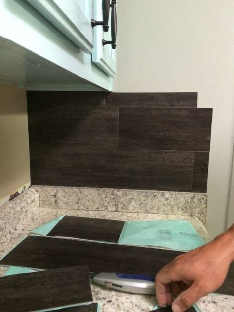 backsplash vinyl tiles our 40 backsplash using vinyl flooring kitchens house