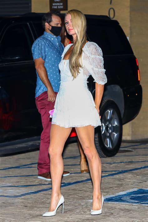 paris hilton flaunts  long legs   white mini dress
