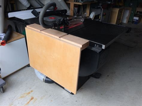 folding out feed table for my sawstop pcs splinters