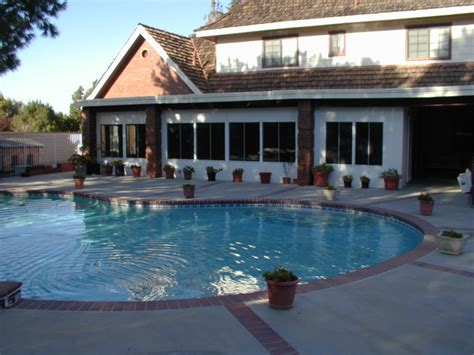 extend the pool season with swimming pool heat pumps home landscapings