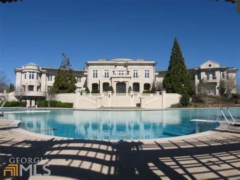 rick ross house atlanta rick ross buys evander holyfield s 109 room mansion in georgia bleacher report