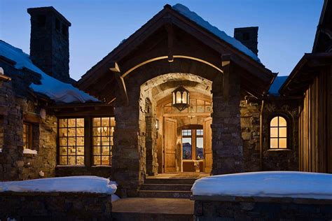 locati architects timber frame mountain home with rustic details in big sky