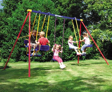 swinging on a swing set children s activities fun in the outdoors