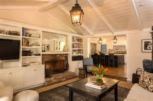 Light fixture will be essential for a living room with vaulted ceiling