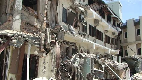 earthquake footage rubble and debris after large indonesian earthquake stock