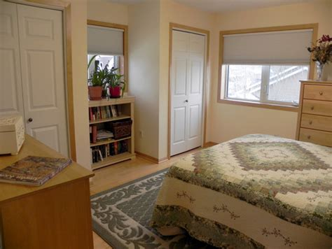all walls yellow maple floors maple trim windows in bedrooms