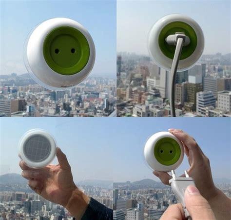solar powered phone charger sticks to window window sockets generate solar power futuristic news