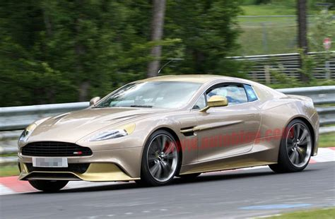 gold aston martin aston martin vanquish goes for the gold on ring as