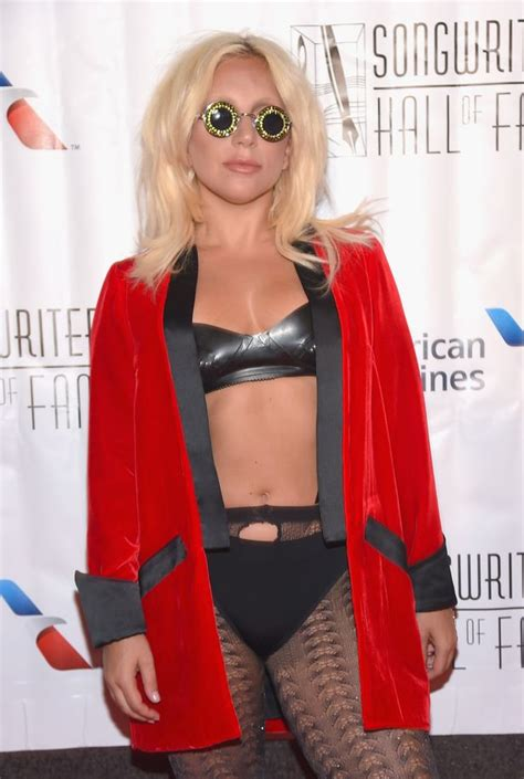 lady gaga accepts contemporary icon award in bra and lady gaga flashes her flesh in ripped tights and a bra at