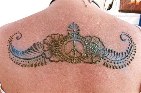 peace henna on upperback