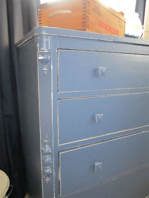 How To Distress Paint A Dresser by Distressing Wood Furniture With Black Paint