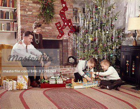 most popular live christmas trees of 1960s 846 02795263em 1960s family in living room tree boys with toys moth jpg 450
