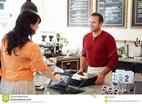 Customer Paying In Coffee Shop Using Touchscreen Stock Photography   Image: 36600022