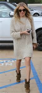 malibu cowboy boots leann rimes covers up with jumper dress and cowboy boots