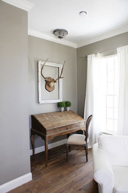 farmhouse bedroom by magnolia homes wall colour is intellectual gray by sherwin williams