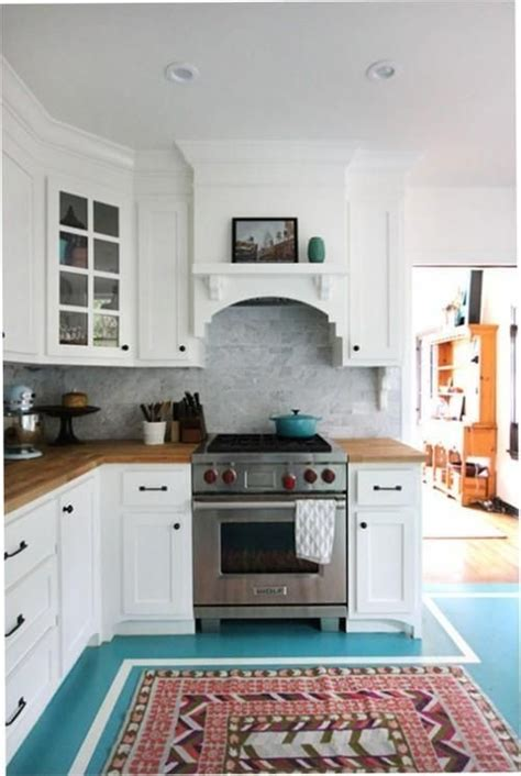 design sponge kitchen 1920s style la home via design sponge kitchen turquoise cabinets and 1920s