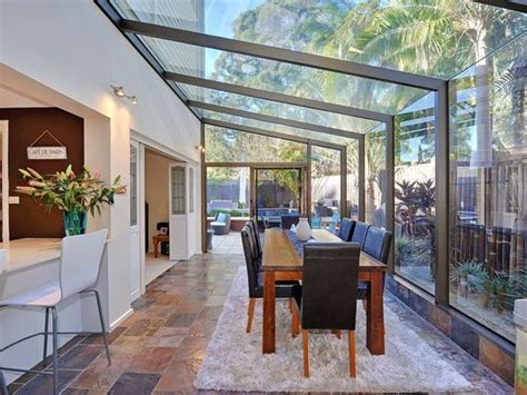 All Glass Sunroom All Glass Conservatory Blends Well With The Garden For A