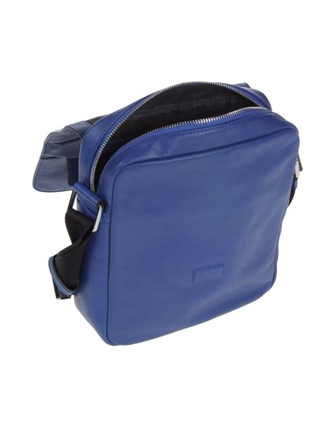 Ck Magnetic With Mini Bag calvin klein cross bag in blue for lyst