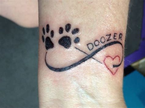 pet name tattoo ideas nice paws heart and infinity symbol added pet s name as