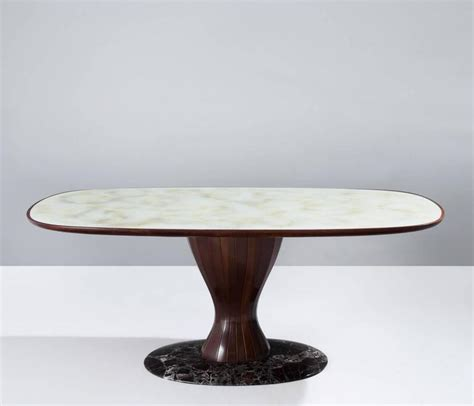 italian pedestal dining table in wood marble and glass