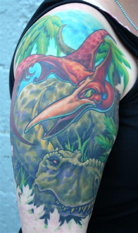 bottom quarter sleeve tattoo dinosaur tattoo half sleeve by phil young tattoos