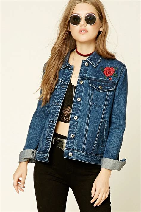 Denim Buttoned Embroidered Jacket a denim jacket featuring tiger and quot world traveler