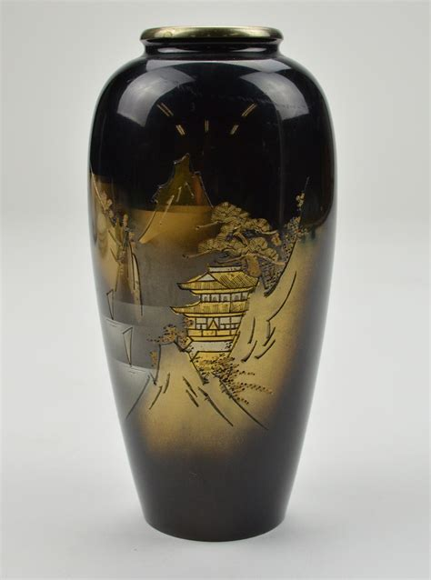 black etched metal vase gold trim decorative