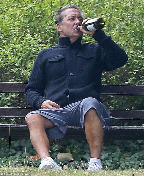 park bench rehab ex arsenal player kenny sansom swigs wine on a bench weeks after rehab daily mail online