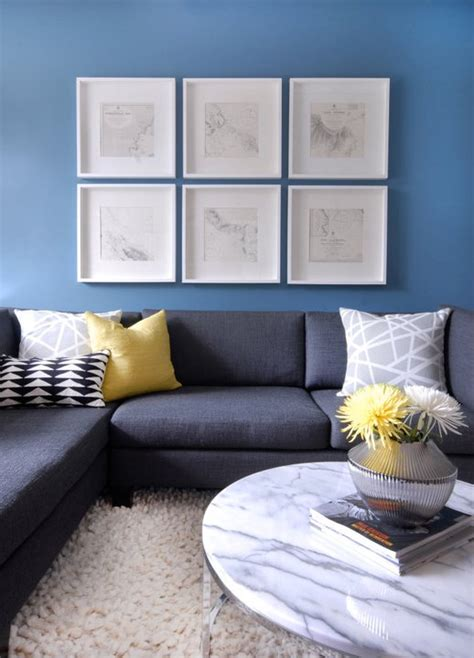 charcoal gray walls living room charcoal gray sectional with yellow pillow contemporary living room cutler design construction