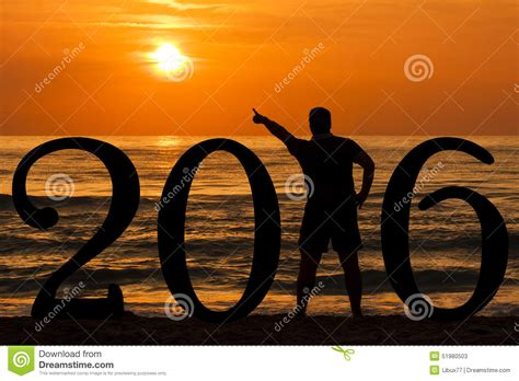 new year time out silhouette 2016 pointing out sun stock photo