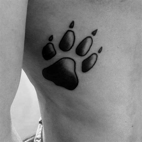 dog tattoo on ribs 70 dog paw tattoo designs for men canine print ink ideas