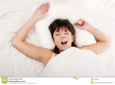 woman in bed lazy woman in bed royalty free stock photography image