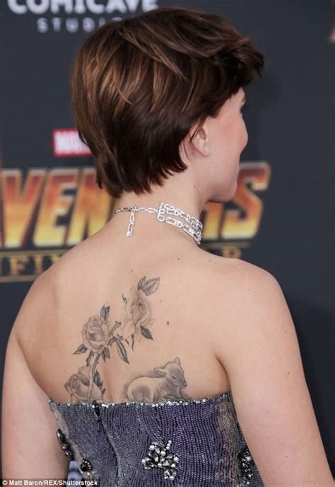scarlett johansson flaunts back tattoo at avengers