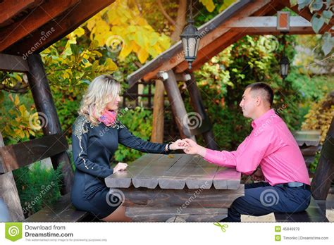 lovers on a park bench lovers on a bench in the park stock photo image 45846979